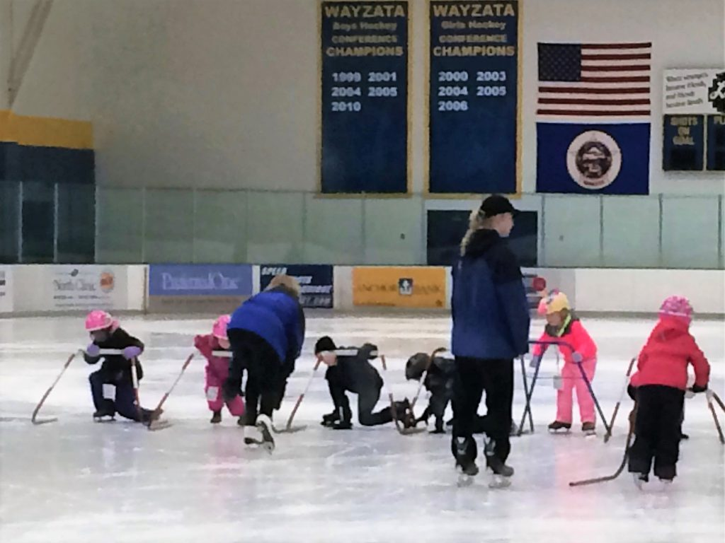 Beginner Skate School class learning to stand on ice
